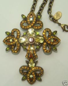 Gorgeous piece - genuine Swarovski rhinestone crystals of light and dark topaz - citrine - peridot and jonquil. Antique bronze finish - this one is a regular bar pin as well as a necklace. It measures 2 and 1/2 inches tall. the chain measures 30 inches long.
