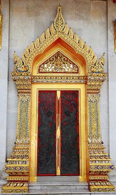 Carved wood door. Bangkok, Thailand