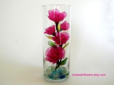 Beautifully artificial pink rose are very lovely in the glass. Handmade nylon fabric arrangement flower and leaves. Nylon Flowers, Organza Flowers, Fabric Flowers, Paper Flowers, Plastic Bottle Flowers, Flower Bottle, Handmade Flowers, Diy Flowers, Flower Crafts