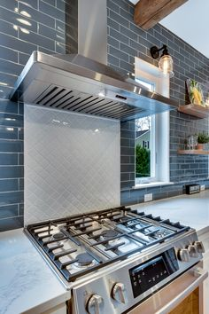 Using two different backsplash tiles is a great way to add more color or pattern to a kitchen design! In this modern farmhouse kitchen, we used a white arabesque tile as an accent backsplash tile under the range hood that paired perfectly with the blue subway tile. To see more of this kitchen design, check out our BLOG! Blue Subway Tile, Blue Tiles, Tile Design, Door Design, Modern Farmhouse Kitchens, Farmhouse Style, Arabesque Tile, Lexington Home, Large Family Rooms