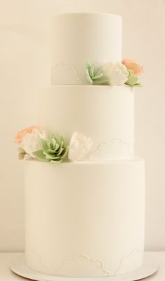 A three tiered succulents- i love how they turned out and how it adds an 'organic' look to the cake! By Hello Naomi cakes