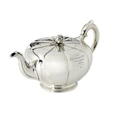 A Silver Teapot by Robert Garrard, In the form of a stylized melon with reeded sides, the finial in the shape of a seed pod. The teapot is inscribed 'From Victoria R. Christmas Maker's Mark: 'RG' for Robert Garrard London, 1867 Vintage Tea, Vintage Silver, Antique Silver, Chocolate Pots, Chocolate Coffee, Tea Blog, Teapots Unique, Silver Teapot, Tea Art