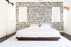 Black and white bedroom with graphic wallpaper