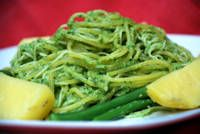 Green Noodles with Spinach Pesto (Tallarines Verdes) - Tallarines verdes (green noodles) have a pesto-like sauce made from both spinach and basil. The sauce also has lots of queso fresco cheese, and is creamier than traditional pesto sauce.