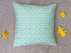 Handmade by SewSallyCreations. This cute green cushion cover features a dizzy bumblebee pattern on the front, and has a yellow cotton fabric on the reverse. The cushion cover has an envelope opening for easy access.