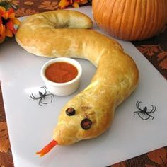 One long calzone, baked in the shape of a snake, can be cut into individual servings after baking. Stuff with your favorite pizza toppings and lots of cheese.