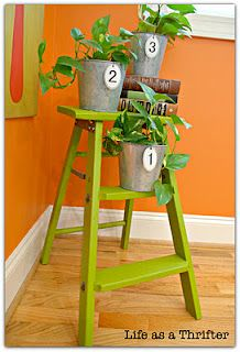 Love this idea for the front porch in black with plants or decor.