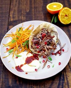 [Jamie Oliver's Moroccan mechoui lamb with carrot and orange salad] shoulder of lamb, butter, ground cumin, ground coriander, sea salt, fresh thyme, fresh rosemary, ground black pepper, garlic, flat breads, pomegranate, Greek yoghurt, Harissa.