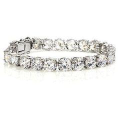 Diamond Tennis Bracelet. I'm not usually into a lot of jewelry...but lately I've been loving these bracelets!!! <3