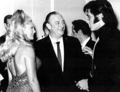 Elvis with comedian and actor Rodney Dangerfield and Alex Shoofey's wife at the reception.