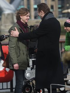 LaineyGossip Liam Neeson, Thomas Brodie-Sangster, Olivia Colson film ten minute Love Actually sequel for telethon