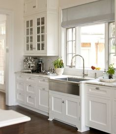 Classic White Galley Kitchen lots of drawers - great use of space in this white galley kitchen