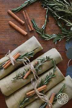 Holiday DIY napkin rings with cinnamon sticks.