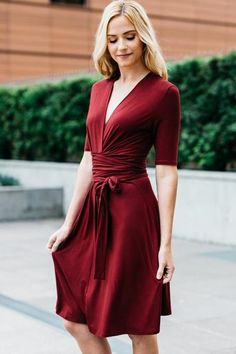A figure-flattering Lucky Duck wrap dress in a beautiful burgundy for the fall season. It features a crossover V neckline, and a self-tie belt secures the wais