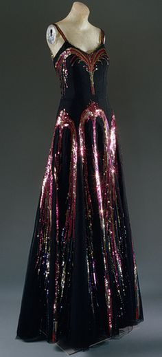 """Gabrielle """"Coco"""" Chanel, 1938 Fireworks. Black silk net with polychrome sequins."""