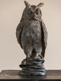 Bronze Finished Metal Sculpture of an Owl, France circa 1920. The true to life representation  and its almost life size scale give this owl a marvelous presence. Because the owl is finished fully in the round it may be seen from any direction with equal pleasure.
