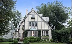 CURB APPEAL – another great example of beautiful design. a Tudor!  With painted brick.