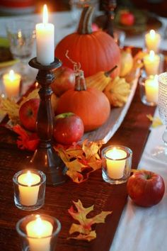 #Fall #wedding: runners over white tablecloths, votive and tall candles and pumpkins and gourds! #wedding #fall #thanksgiving #table