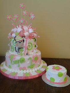 pink and green monkey cake with a matching smash cake