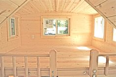 6'x8' loft with high roomy ceiling and 5 windows. Great for office!