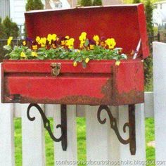 Rustic planter made out of an old tool box. Guess what I'm going to be doing with my old toolbox!