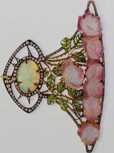Lalique Pendant: Rose-cut diamond openwork plaque, w/center opal cabochon, w/in a rose-cut diamond surround: green plique-à-jour enamel & gold leaves: carved pink glass rose cascade/ mounted in gold : artistsandart.org :: diamondsandrhubarb.blogspot.com : Image Christie's