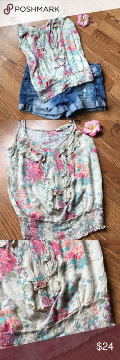 🆕LISTING!!American Rag Pretty ruffled floral top Gorgeous lightweight top has adjustable straps and elastic around bottom. Super cute!!! Base color is like a creamish/ off white color with pink purple blue green and peach floral pattern. Length hits me at my hips. American Rag Tops Tank Tops