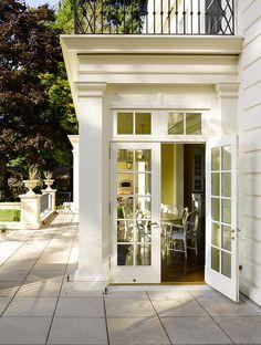 side entrance with french doors, transom   beautiful trimwork   stunning veranda