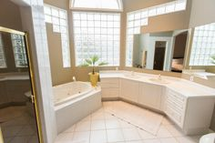 A luxurious bathroom in this executive home. Look at all those windows?! Photo by Digital Video Listings.