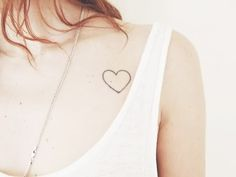 Heart On Chest Tattoo