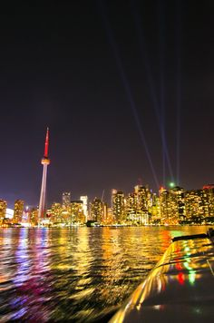 Back to the city from Island, 12 September, 2012 with Dan Trepanier - Note lights shining up from the ACC during a Madonna convert. - photo by Nickles Mills ⛵⛵⛵ Laser Sailboat, Matt Mills, Sailing Lessons, Centre Island, Toronto Island, Toronto Skyline, Summer Rain, Toronto Canada, Gta