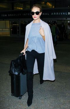 Rosie Huntington-Whiteley knows just like every other celeb that the most flattering piece in your wardrobe is a long trench coat or duster jacket to elongate your figure and flatter every body type