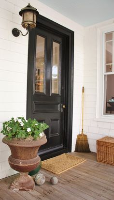 Classic Black  front door on a farmhouse porch at For the love of a House