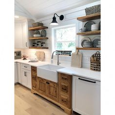23 Rustic Country Kitchen Design Ideas to Jump Start Your Next Remodel - The Trending House Farmhouse Kitchen Cabinets, Farmhouse Sinks, Country Farmhouse Kitchen, Open Cabinet Kitchen, Shiplap In Kitchen, Farmhouse Kitchen Lighting, Kitchen Sink Window, Kitchen Ideas Without Cabinets, Small Cottage Kitchen