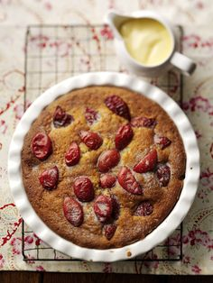 Sticky Plum Clafoutis with vanilla creme anglaise Recipe, Food & Prop styling: Natalie Seldon Photography: Joff Lee