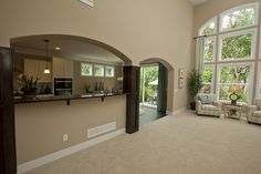 Custom-stained Columns Flank the Archway to the Kitchen