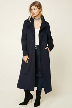A midweight wool-blend overcoat featuring a basic collar, a double-breasted button-down front, front welt pockets, and long sleeves.