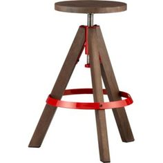"rig barstool  cb2.com  raising the bar. Handmade sustainable mango wood round twists up/down four inches to park at bar/counter. Hi-gloss red powdercoated iron kicks up industrial edge on footrest and around stainless steel center screw.  24"" to 28"""