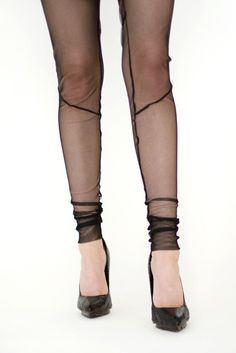Transparent diagonal seam leggings by Genevieve Savard