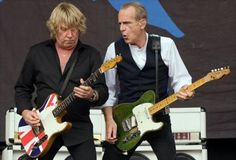 Rick Parfitt (left) and Francis Rossi of Status Quo. Rick Parfitt, Steel Panther, Live Aid, Greatest Rock Bands, Robert Smith, Status Quo, Guitar For Beginners, Guitar Tips, Rock Concert