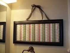 Even cuter hair accessory holder. Frame with fabric/chicken wire to hold bows.