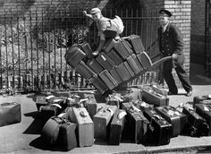 19th May 1940: A porter pushing the luggage of evacuees bound for Wales on a trolley at a London railway station, with a young boy perched on top of the suitcases. (Photo by Reg Speller/Fox Photos/Getty Images) Credit Stringer / Hulton Archive / Getty Images / Universal Images Group