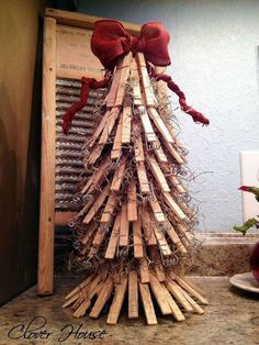 clothespin christmas tree, christmas decorations, repurposing upcycling, seasonal holiday decor, This little tree started out with an empty paper towel roll and ended up looking so adorable Beach Christmas Trees, Pallet Christmas Tree, Christmas Time, Christmas Crafts, Christmas Decorations, Xmas, Christmas Ornaments, Holiday Decor, Christmas Popcorn