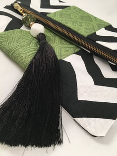 Bold and graphic foldover clutch in a black and white chevron with a fun lime green stripe. -  cooper & oliver