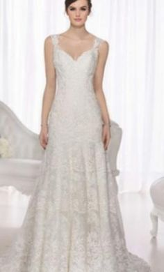 Stella York 5948: buy this dress for a fraction of the salon price on PreOwnedWeddingDresses.com