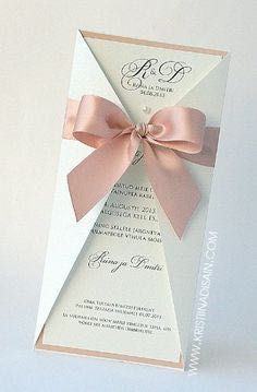 Blush pink ribbon - with feather not a bow?