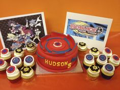 Beyblade-themed fondant cake with beyblade cupcakes and background pics.