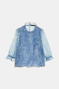 Semi-sheer blouse with high collar and below-the-elbow length sleeves with ruffled elastic cuffs. lined interior at front. back opening and button closure. High Street Fashion, Denim Blouse, Sheer Blouse, Animal Print Blouse, Organza, Spring Tops, High Collar, Zara Tops, Ideias Fashion