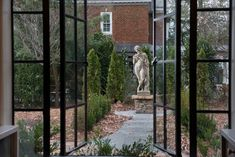 100 year old windows still trending today. Beautiful statue surrounded by cypress trees as a backdrop once fully grown. Texas Coast, Garden Urns, Cypress Trees, Trending Today, Old Windows, Garden Inspiration, Porches, Statues, Pools