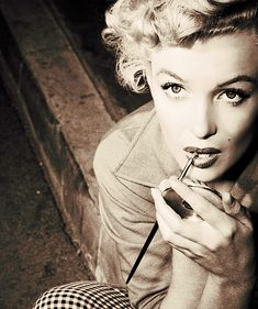 Marilyn Monroe doing her make-up: she used seven different shades of red to create her signature lip